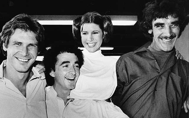 Elenco de Star Wars formado por Harrison Ford (Han Solo); Anthony Daniels (C3PO), Carrie Fisher (Leia) y Peter Mayhew (Chewbacca)
